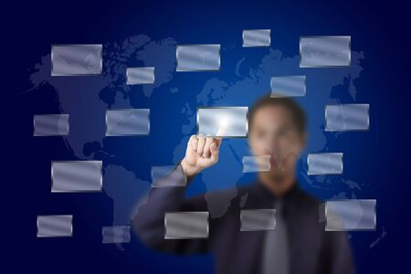 business man push a touch screen button with world map background Stock Photo - 13193946