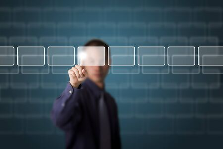 business man push a touch screen button Stock Photo - 13184780