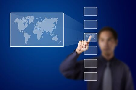 enlarge: business man push a touch screen button to enlarge world map