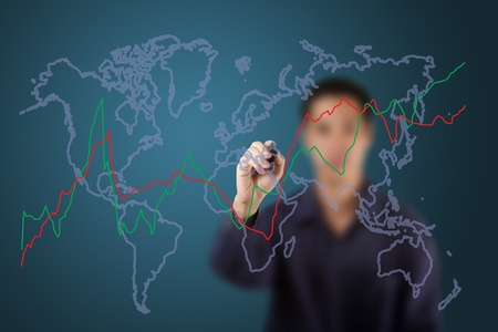 male hand drawing fluctuate upward trend graph on world map photo