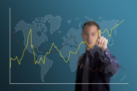 fluctuate: business man selecting to point at fluctuate upward trend graph on world map