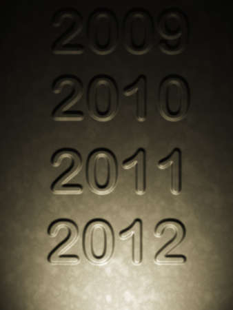 happy new year 2012 highlighted on year series on craved gold metal plate photo