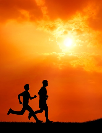 two healthy young man run together at sunset silhouetted photo