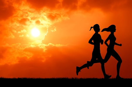 two healthy young woman run together at sunset silhouetted photo