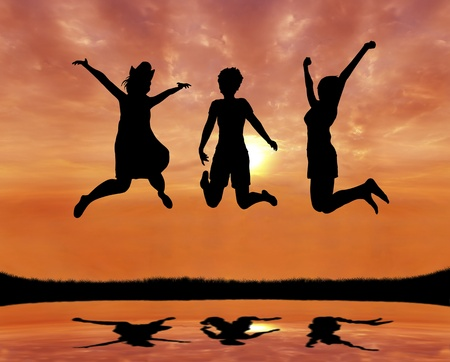 silhouette of teen girl friends jumping with joy at sunrise photo