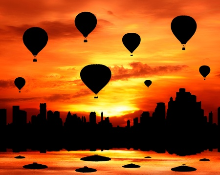 group of hot air balloon fly over city at sunset silhouetted photo