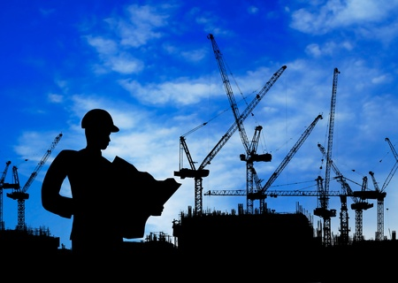 high rises: silhouette of an engineer working on construction site at day time Stock Photo