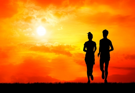 run woman: pair of healthy man and woman run together at sunrise silhouetted