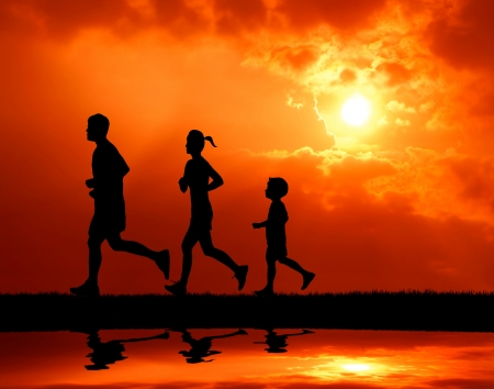 family exercise: silhouetted runner family running together at sunset