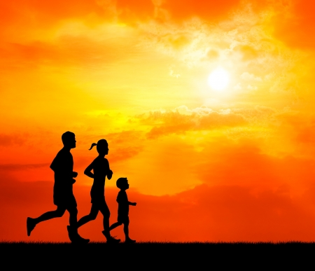 family exercise: running family at sunset silhouetted Stock Photo