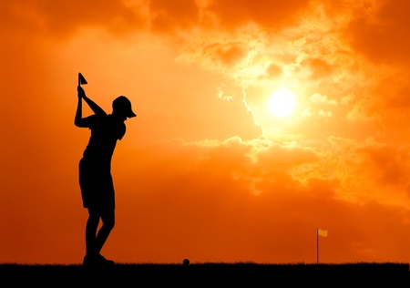 male golfer aim at golf ball at sunset silhouetted photo