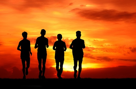 healthy man group running at sunset silhouetted photo