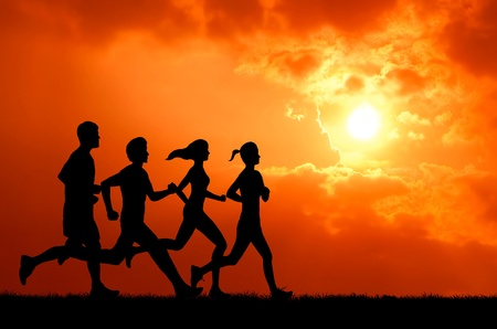 healthy man and woman group running at sunset silhouetted Stock Photo - 13224602