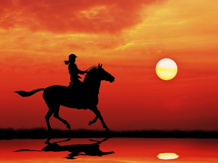 silhouetted woman jockey riding horse running on meadow  at sunrise photo