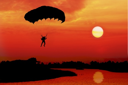 parachute at sunset silhouetted photo