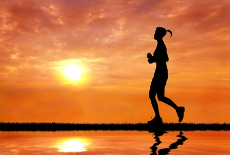 woman running at sunrise silhouetted silhouetted photo