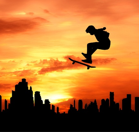 high jump: young man skateboarder jumping over the city during sunset silhouetted, extreme sport