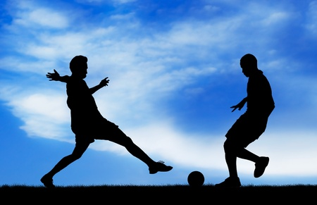 snatch: two soccer players catching the ball silhouetted