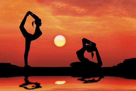 silhouetted of beautiful couple woman Yoga in the evening Stock Photo - 13224353