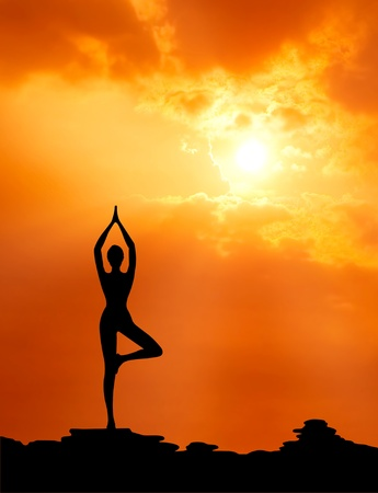 healthy woman  practice yoga at sunset silhouetted photo