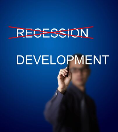 businessman make a red cross mark on recession and writing development instead photo