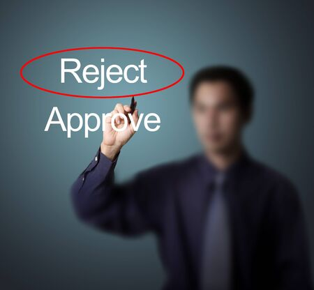 business man select reject by make red mark on whiteboard Stock Photo - 13224490