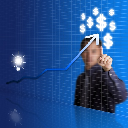 business man pointing at idea change to money graph photo