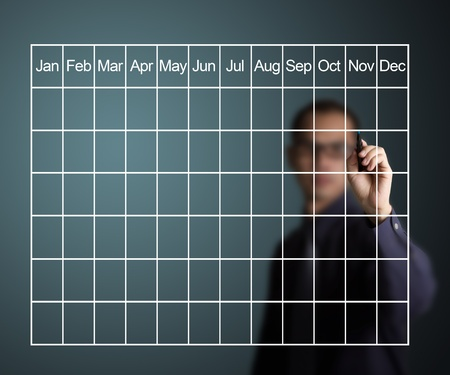 business man drawing monthly schedule photo