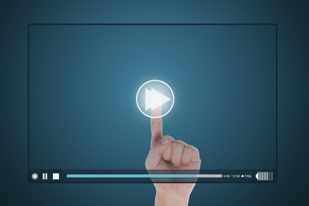 play button: hand push fast forward button on touch screen to run video clip Stock Photo