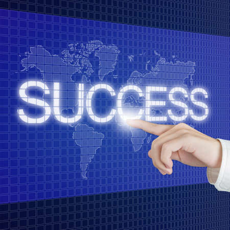 hand push success button on touch screen with world map background Stock Photo - 13224995