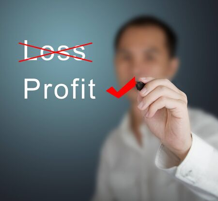 business man eliminate loss and choose profit photo