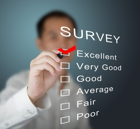 business man checking  excellent on survey form photo