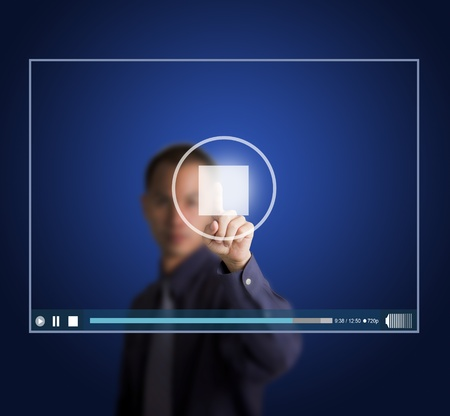 business man push stop button on touch screen to end video clip photo