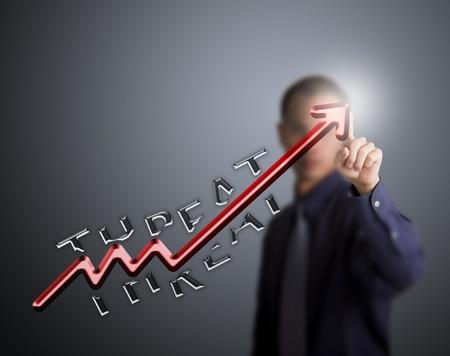 upward struggle: busines man pointing at upward arrow break through the threat Stock Photo