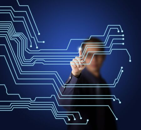 electronic circuit: business man pointing at virtual electronic circuit board on touchscreen
