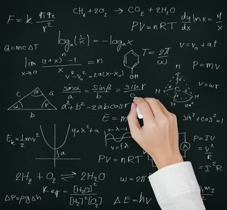 teacher hand writing various high school maths and science formula on blackboard photo