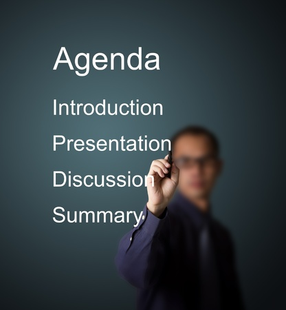 meeting agenda: business man writing meeting agenda