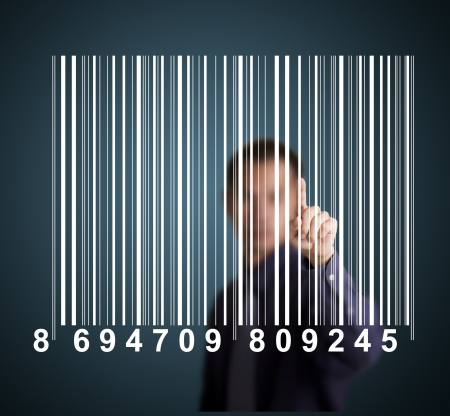 business man pointing at bar code on touch screen photo