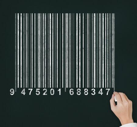 male hand drawing bar code on chalkboard photo