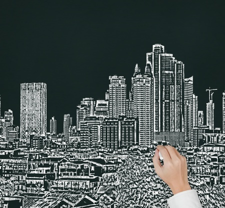 hand drawing urban city building on chalk board photo
