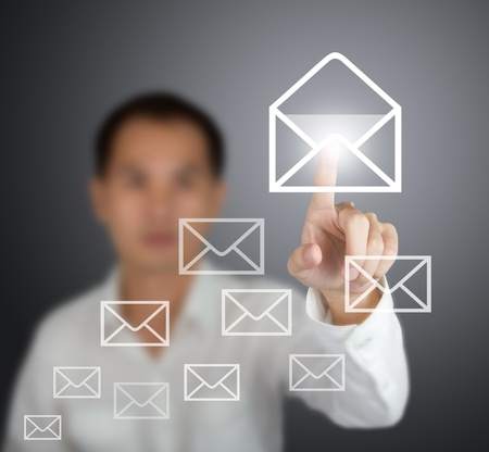 business man open email by press mail icon on touch screen