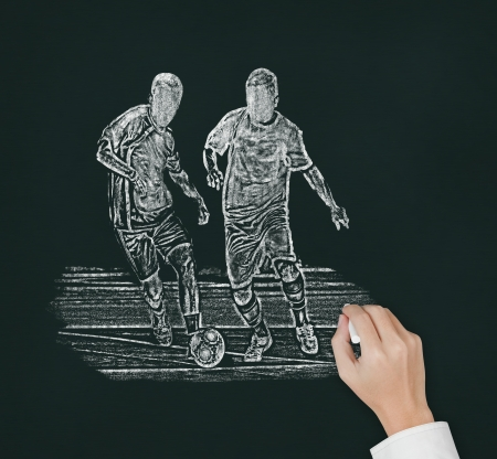soccer coach hand drawing two player catching the ball photo