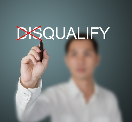 business man change disqualify to qualify by write red cross mark photo