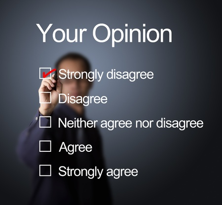 concur: business man writing red mark on strongly disagree choice on opinion survey form Stock Photo