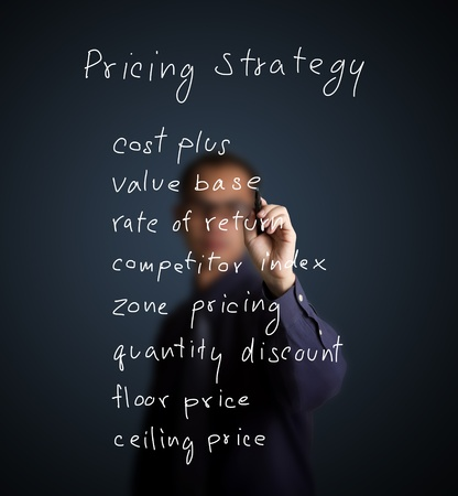 business man writing marketing concept - pricing strategy Stock Photo - 13241799