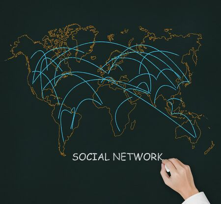 male hand drawing social network link on world map photo