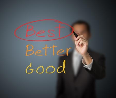 best hand: hombre de negocios marca de escritura en la mejor opci�n Foto de archivo