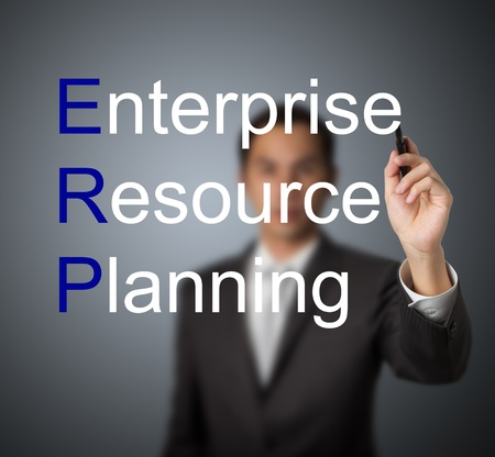 businessman writing enterprise resource planning (ERP) system concept for supply material management business photo