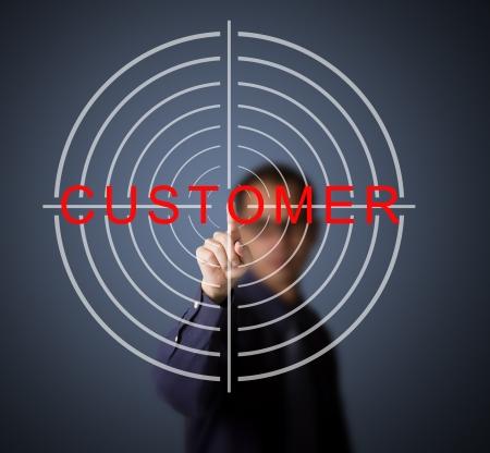 achievable: businessman aim at target customer