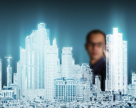 business man drawing modern urban city building photo